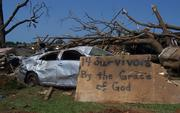 Sign that says '14 survivors by the grace of God.'