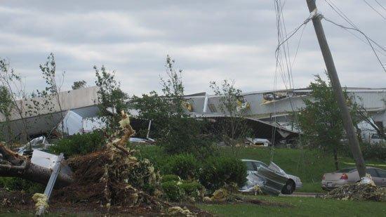 Alabama Tornado Damage: Industrial buildings and vehicles were damaged along Coalburg Road in Daniel Payne Industrial Park.