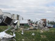 Alabama Tornado Damage: Vehicles and an industrial building along Coalburg Road sustained severe damage on Wednesday.