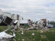 Alabama Tornado Damage: Damage trucks and debris in Daniel Payne Industrial Park along Coalburg Road.