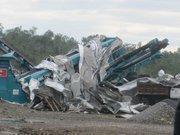 Alabama Tornado Damage: Industrial equipment sustained heavy damage along Coalburg Road in Daniel Payne Industrial Park.