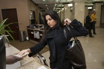 Ayesha Siddiqi checks out of the Sheraton Birmingham Hotel. Local hotels have reported a recent uptick in corporate travel.