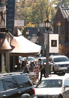 Customers dine outside of Chez LuLu in English Village, a community in Mountain Brook.