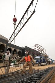 Bryant Blake, left, and Johnny Quinlan work at the Parker High School site.