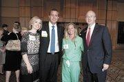 BB&T's Melanie Geary and honoree Joshua Petty with Johnson & Johnson's Sarah Petty and Burton McDonald of BB&T.