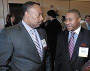 Alabama Power Co.'s Tony Smoke and Jonathan Porter, who was an honoree.