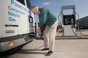 Daryl O'Barr of Airport Express fills up the company's dual-fuel van, which can be driven from the Birmingham-Shuttlesworth International Airport to Atlanta on a single tank of CNG.