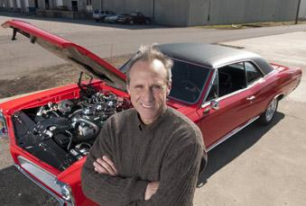 Airport Express owner Mark McConville and his modified GTO that runs on compressed natural gas or regular gasoline.