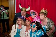 Employees of Renal Billing, which was one of the Best Places to Work, enjoy the photo booth at the event.