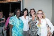 YMCA of Greater Birmingham's Velma Williams, Caroline Bundy and Lisa Jones with ACIPCO's Sherri Snow, second from left.