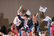 PricewaterhouseCoopers, winner of the spirit award, celebrates with a mock Olympic march.