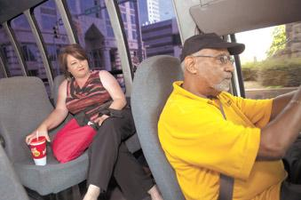 Central Parking's Don Dodson drives Balch & Bingham LLP employee Tracy Robbins from her downtown office to a parking deck. The shuttle is one perk the company offers its employees.