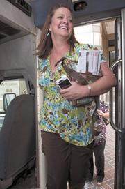 Balch & Bingham employee Cristie Huff rides a free shuttle from their downtown office to a parking deck.