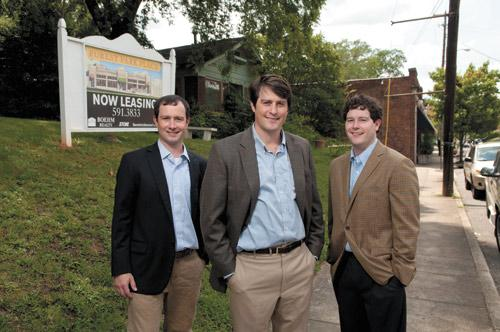 Brothers Matt, Brian and Chris Boehm stand in front of the planned site for Forest Park Place.