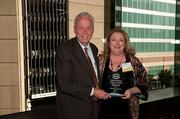 Patricia Pritchett of the University of Alabama Health Services Foundation receives her award from Littler Mendelson's Jay St. Clair.