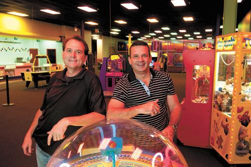 Marty Felts and Mark Gold are co-owners of the Edge Party Zone in Crestwood. Experts say market conditions may attract more investors like Gold, who plans to acquire 1 million square feet in Alabama.