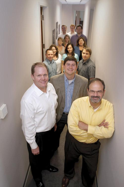 Doozer leaders Sandy Syx, Heath Wade and Ron Perkins, in the front, with employees.