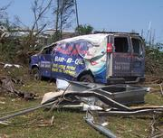 The massive tornado crumpled and tossed a Full Moon Bar-B-Que delivery truck  across McFarland Boulevard in Tuscaloosa.