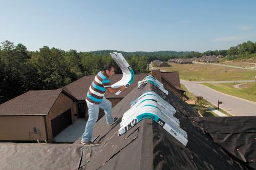 Javiar Mondragod works on the roof of a new home under construction in the Cotswolds neighborhood in Liberty Park. A $30 million project is planned nearby.