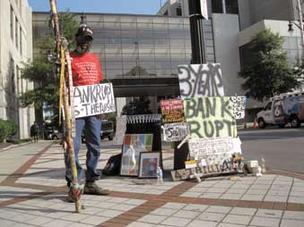 Joe Minter protests in favor of bankruptcy at the Jefferson County Courthouse Aug. 12.