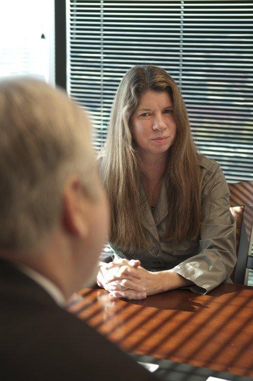 Kate Musso, an attorney at Jones Walker, talks with fellow attorney Steven Casey.