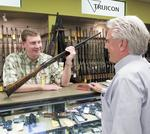 Gun retailers firing on all cylinders due to economic, political uncertainty