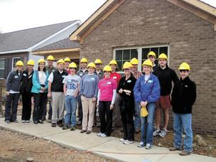 Maynard Cooper attorneys volunteering with Habitat for Humanity.