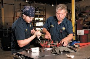 Cruz Sanchez and Jose Sanchez repair a hydraulic piston at Alabama Hydraulic Services, a company in McKinney Capital's portfolio.