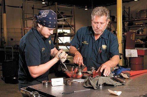 Cruz Sanchez and Jose Sanchez repair a hydraulic piston at Alabama Hydraulic Services, a company in McKinney Capital's portfolio.