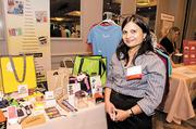 Kopri Promotions' Samata Shah shows off her company's products at its booth.