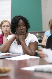 Anita Scott Smith of the Department of Human Resources listens to a lecture about nonprofit boards at the Junior League of Birmingham Leadership Institute.
