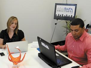 CEO Robin Hunt and partner Daniel Bishop in a planning meeting at ThinkData in Innovation Depot.