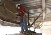 Frances Piz uses a jackhammer to  remove brick on the exterior of the  UAB Comprehensive Cancer Center.