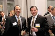 Reliance Financial Group's Ham Poynor and honoree Bobby White, also of Reliance.