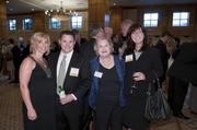 Amy Strong and finalist John Paul Strong of Strong LLC with Wagnon & Associates' Nancy Wagnon and SGI Delivery Solutions' Sandi Gornati.