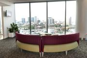 A common area with a view of the city skyline.