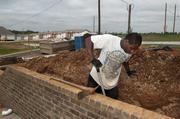 Tyron Taylor works on a rebuilding project in Pratt City.