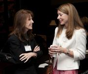 Sandy Marvin and Christi Daniel Lunsford network before the breakfast event at the Harbert Center.