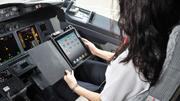 Even pilots for airlines, such as this Alaska Air pilot, are using iPads in their workplace.