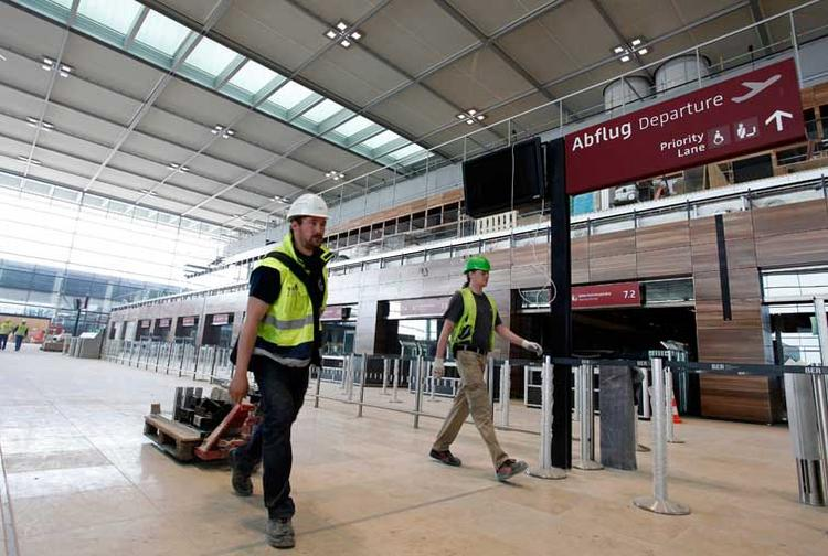 Back in May 2012, when this photo was taken, workers thought they were in the final stages of their work on Berlin's new airport. But a number of issues delayed the opening and it now looks like Berlin Brandenburg Airport Willy Brandt may not open until 2015.