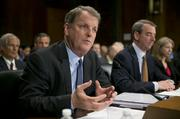 Doug Parker of U.S. Airways Group Inc. and Tom Horton of AMR Corp.'s American Airlines faced heavy scrutiny before a Senate panel in March about their companies' merger plans.