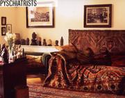 The most famous psychiatrist might be Sigmund Freud, whose couch is shown in the Freud museum. Psychiatrists are paid an average of $177,520 annually.