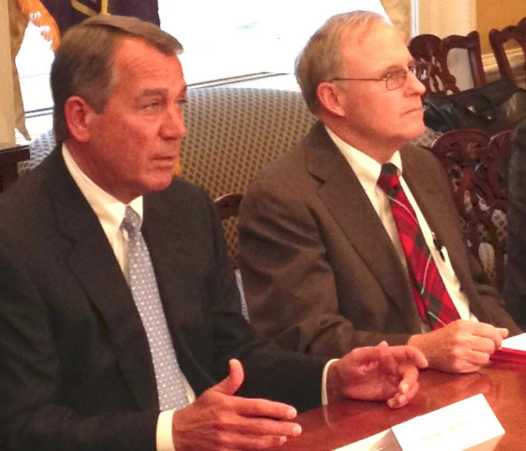 House Speaker John Boehner, left, recently talked taxes with Dan McGregor, chairman of McGregor Metalworking Cos. in Springfield, Ohio, and other small business owners.