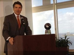 Texas Gov. Rick Perry accepts an award in Tampa, honoring his role in job creation.