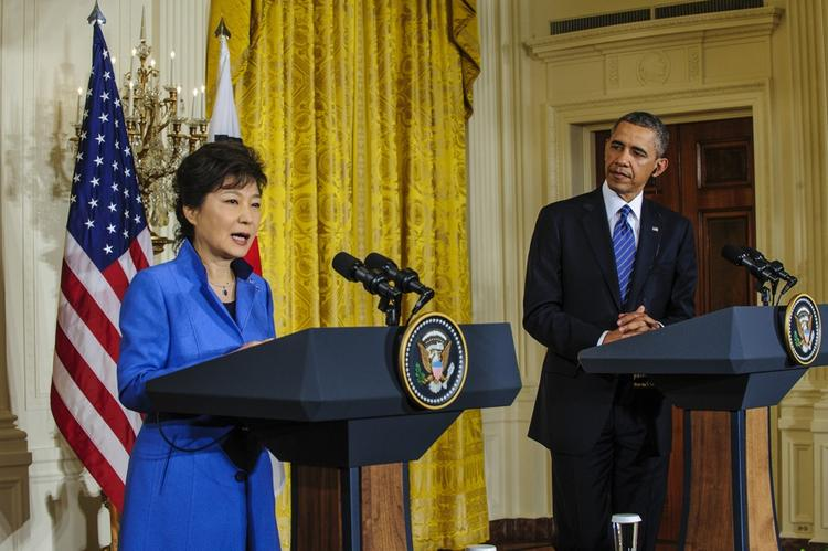 South Korean President Park Geun-hye speaks at White House news conference as President Barack Obama listens.