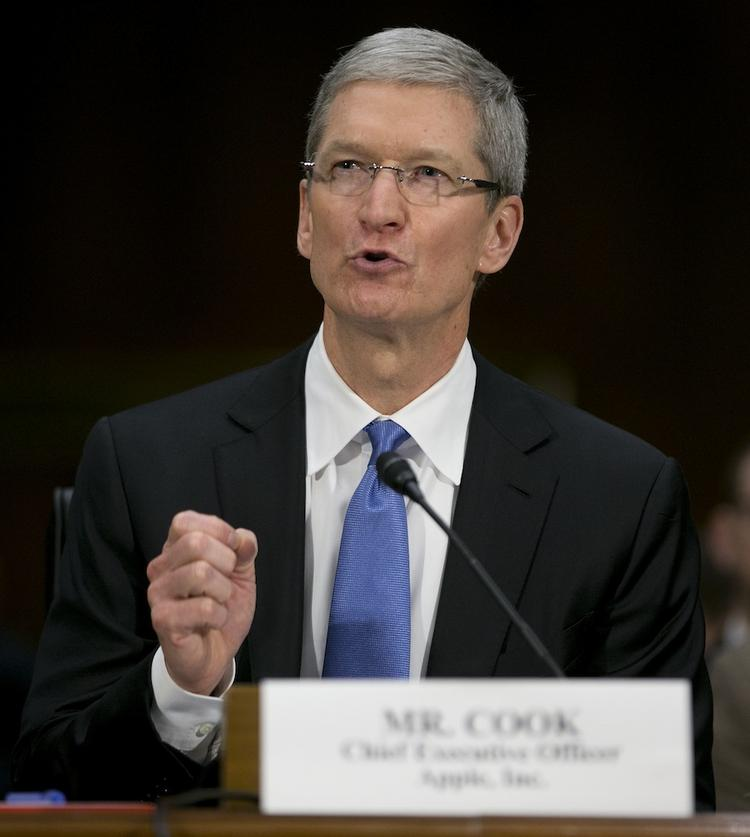Apple CEO Tim Cook defends his company's tax strategies at a U.S. Senate hearing.