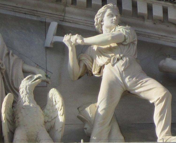 This is a sculptural detail from the outside of the U.S. Capitol, but the ax will fall on federal spending March 1 unless Congress comes up with an alternative.
