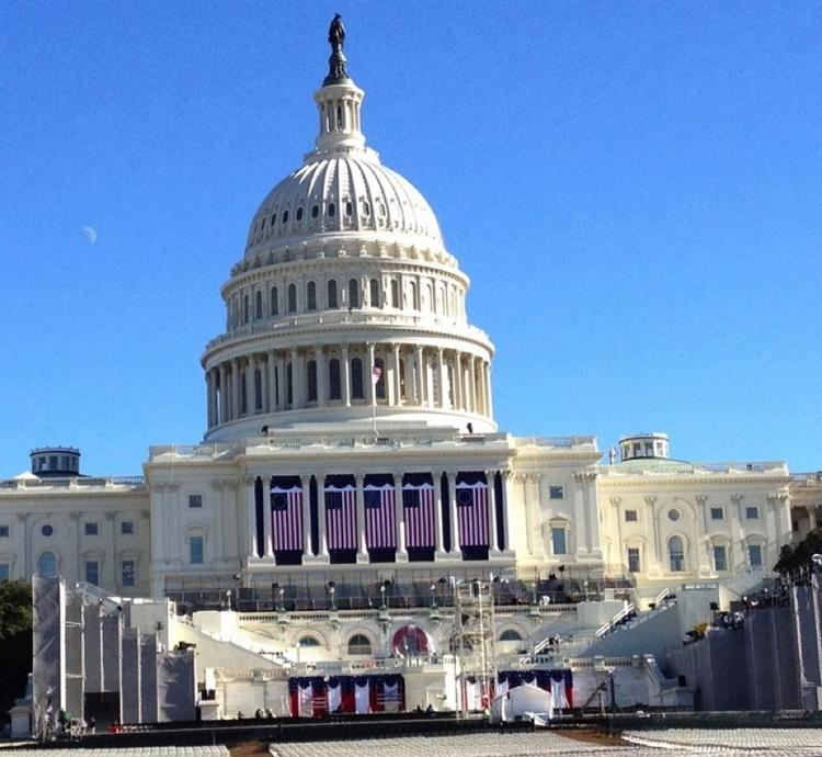 The scene is set for a show of unity at the Capitol Monday for President Barack Obama's inauguration, but that will quickly be followed by more partisan fireworks over federal spending.