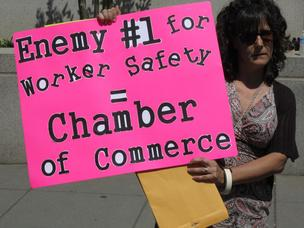 Protester pickets U.S. Chamber of Commerce Friday over its efforts to curb OSHA regulations; corporations can expect protests over various issues at their shareholder meetings this spring.