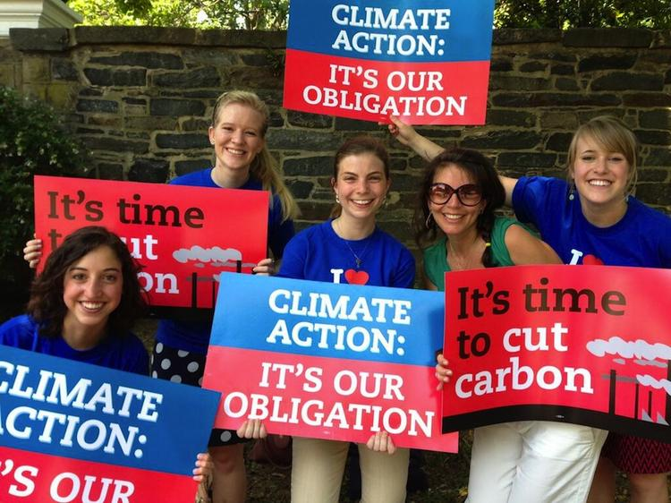 Young people show their support for President Barack Obama's climate change plan at Georgetown University, where the president spoke today.
